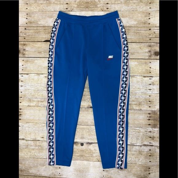 Nike pants with stripe down the side